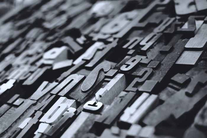 greyscale photo of typesetting pieces